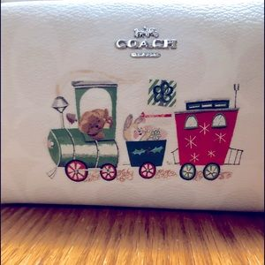 Coach/Snoopy toiletry/makeup bag.